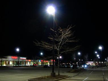 Parking lot with IESNA cutoff light fixtures, illustrating glare.