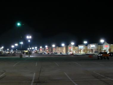 Mall parking lot with unshielded light fixtures.