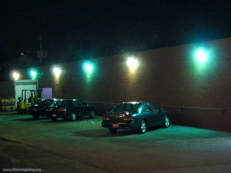 Wallpack light fixtures produce glare and waste energy.
