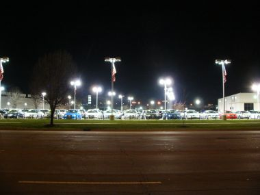 Auto dealership with poor yard lighting.