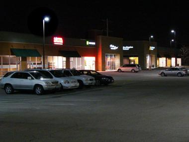 Parking lot with fully shielded light fixtures on poles.